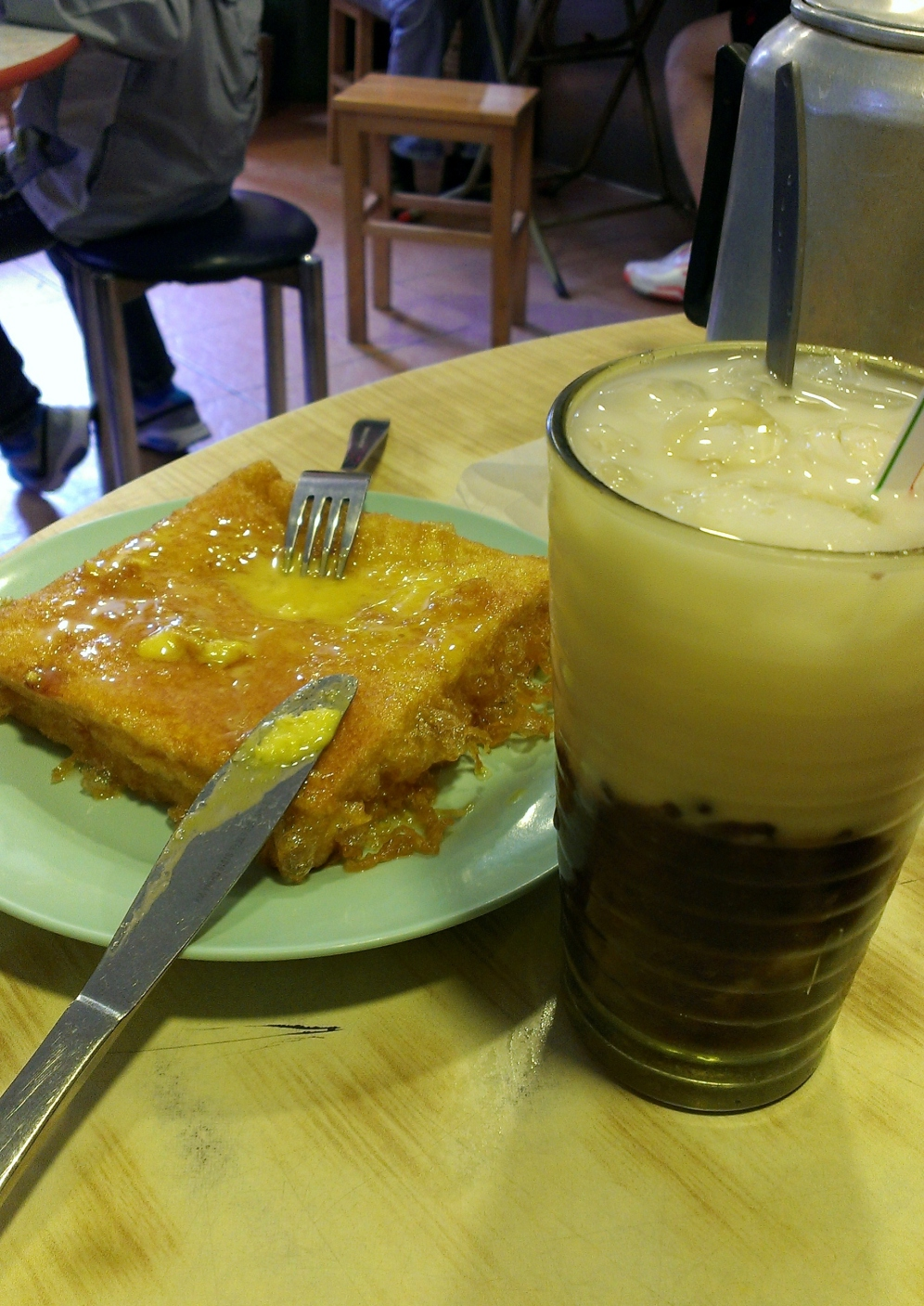 """Pan fired """"French toast' with special red bean drink."""